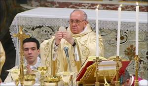 Popefrancisraisesthehost